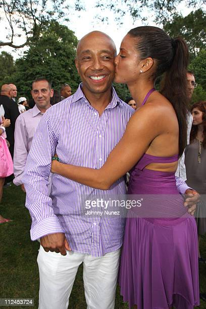 Russell Simmons and Porschla Coleman attend the 9th annual Art for Life benefit gala on July 19, 2008 in East Hampton, New York.