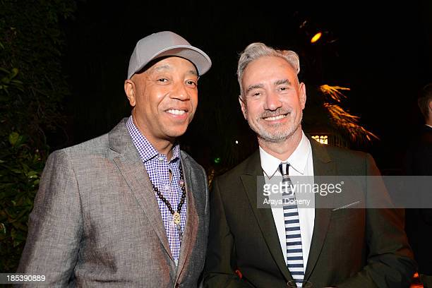 Russell Simmons and Roland Emmerich attend An Evening Under The Stars Benefiting The LA Gay Lesbian Center on October 19 2013 in Los Angeles...