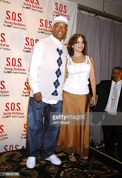 Russell Simmons and Rosie Perez during SOS The BET Telethon Relief Press Room at CBS Studios in New York New York United States