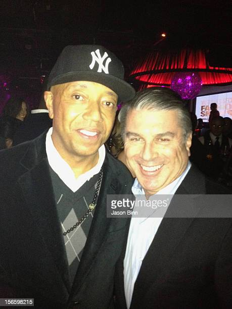 Russell Simmons and Ted Harbert pose circa November 2012 in New York City.