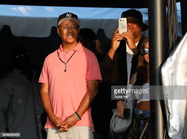 Russell Simmons attends as Nas performs onstage during Day 3 at The Meadows Music Arts Festival at Citi Field on September 17 2017 in New York City