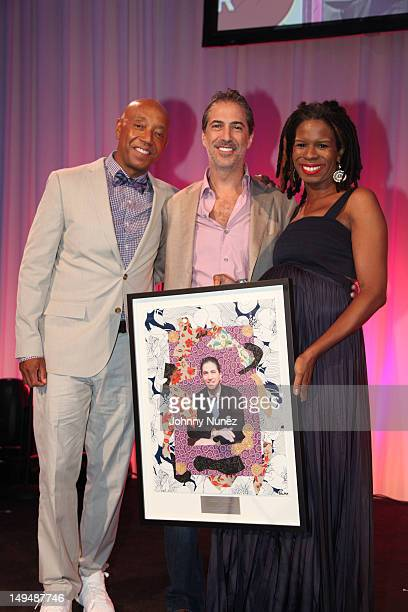 Russell Simmons, Marc J. Leder and Tangie Murray attend the 13th Annual Russel Simmons Rush philanthropic ART FOR LIFE on July 28, 2012 in East...