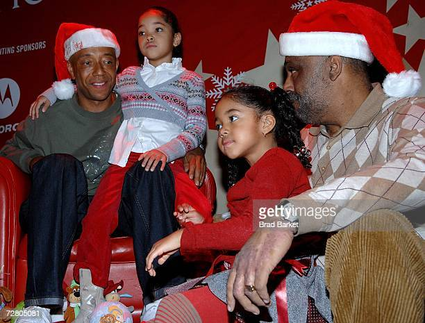 Russell Simmons Ming Lee Simmons Aoki Lee Simmons and Danny Simmons attend the Rush Philanthropic Arts Foundations Youth Holiday Party at Irving...