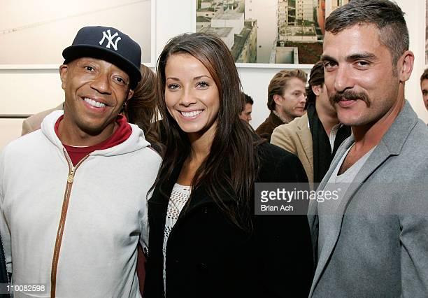 Russell Simmons, Porschla Coleman and photographer Douglas Friedman attend the Blue&Cream Bowery reception for Douglas Friedman's photography and the...