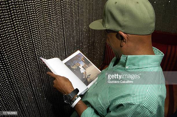 Russell Simmons reads in the early morning hours at the Stellan Holm Gallery Sante D'Orazio's Katlick School Launch hosted by Imperia Vodka at Skybar...