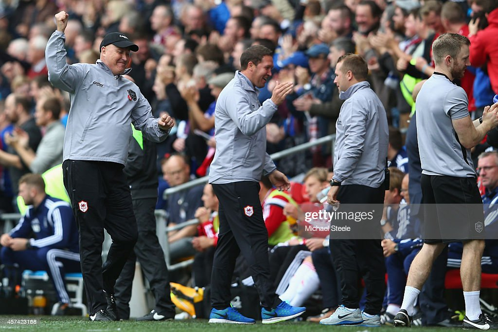 Russell Slade (L) the new manager of Cardiff City celebrates his sides first goal during the Sky Bet Championship match between Cardiff City and Nottingham Forest at Cardiff City Stadium on October 18, 2014 in Cardiff, Wales.