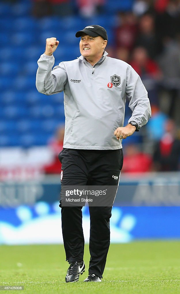 Russell Slade the new manager of Cardiff City salutes the home supporters after his sides 2-1 victory during the Sky Bet Championship match between Cardiff City and Nottingham Forest at Cardiff City Stadium on October 18, 2014 in Cardiff, Wales.
