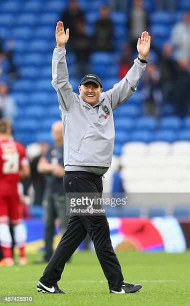 Russell Slade the new manager of Cardiff City salutes the home supporters after his sides 2-1 victory during the Sky Bet Championship match between...