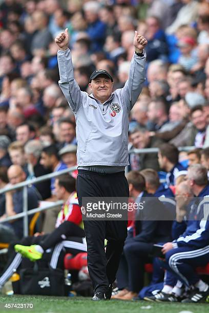 Russell Slade the new manager of Cardiff City salutes the home supporters during the Sky Bet Championship match between Cardiff City and Nottingham...