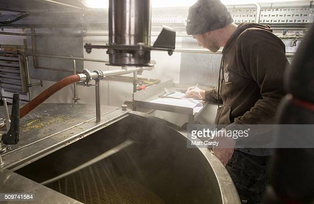 Russell Sykes checks the tanks which are used to brew beer at the Wild Beer Co brewery at Lower Westcombe Farm on February 11 2016 near Evercreech...