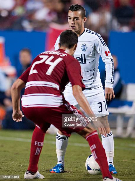 Russell Teibert of the Vancouver Whitecaps FC makes a move against Matt Hedges of FC Dallas on September 15 2012 at FC Dallas Stadium in Frisco Texas