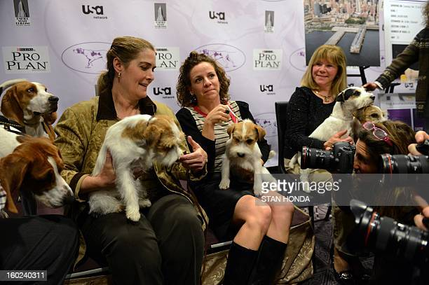 Russell Terrier owners Candace Lundin Roxanne Sutton and Sue Sobel with their dogs and two Treeing Walker Coonhounds during a press conference...