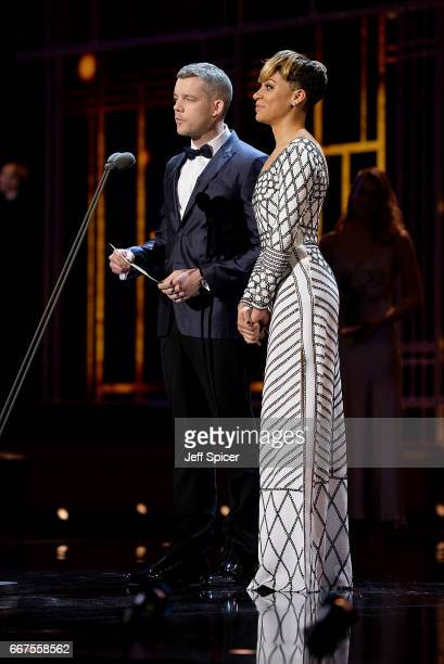 Russell Tovey and Cush Jumbo present the Best Actor award on stage during The Olivier Awards 2017 at Royal Albert Hall on April 9 2017 in London...