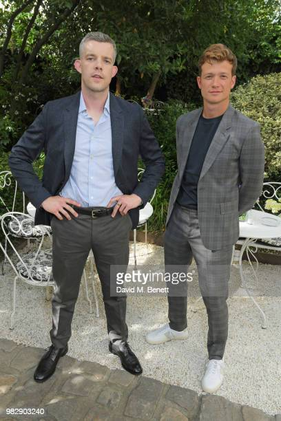 Russell Tovey and Ed Speleers both wearing Paul Smith attends the Paul Smith SS19 VIP dinner during Paris Fashion Week at Hotel Particulier...