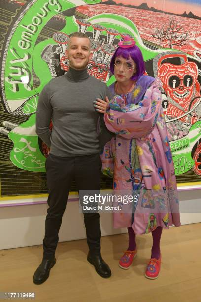 Russell Tovey and Grayson Perry attend a private view of Grayson Perry Super Rich Interior Decoration at Victoria Miro Gallery on September 25 2019...