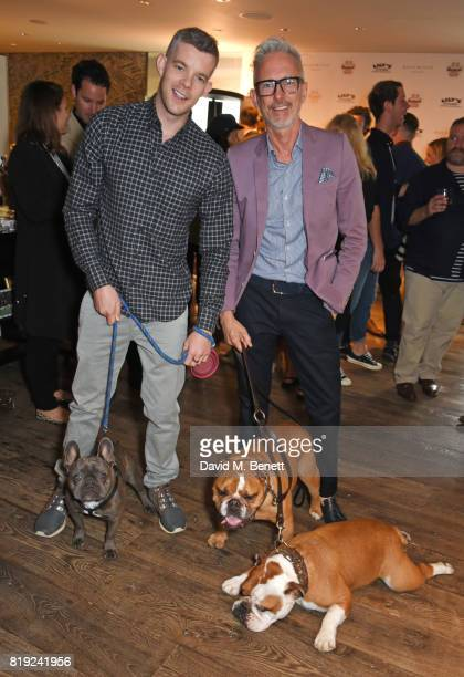 Russell Tovey and Patrick Cox attend the launch of Rosewood's Canine Luxury Experience and the Barbour Dogs Loyalty Scheme hosted by Rosewood London...