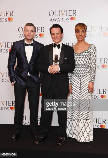 Russell Tovey Jamie Parker winner of the Best Actor award for 'Harry Potter And The Cursed Child' and Cush Jumbo pose in the winners room at The...