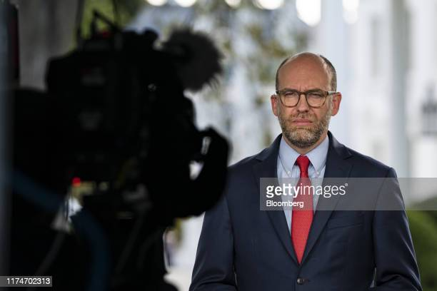 Russell Vought acting director of the Office of Management and Budget listens during a television interview at the White House in Washington DC US on...