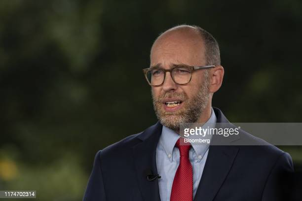 Russell Vought acting director of the Office of Management and Budget speaks during a television interview at the White House in Washington DC US on...