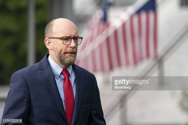 Russell Vought acting director of the Office of Management and Budget arrives for a television interview at the White House in Washington DC US on...