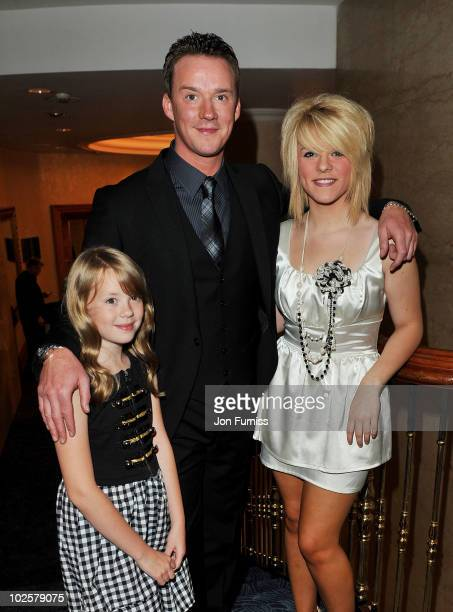 Russell Watson and daughters Hannah and Rebecca Watson attend the 35th Nordoff Robbins 02 Silver Clef Awards at London Hilton on July 2 2010 in...