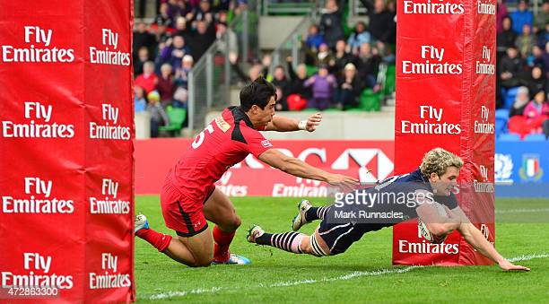 Russell Weir of Scotland scores a try during the Emirates Airlines Rugby 7s match between Canada and Scotland at Scotstoun Stadium on May 10 2015 in...