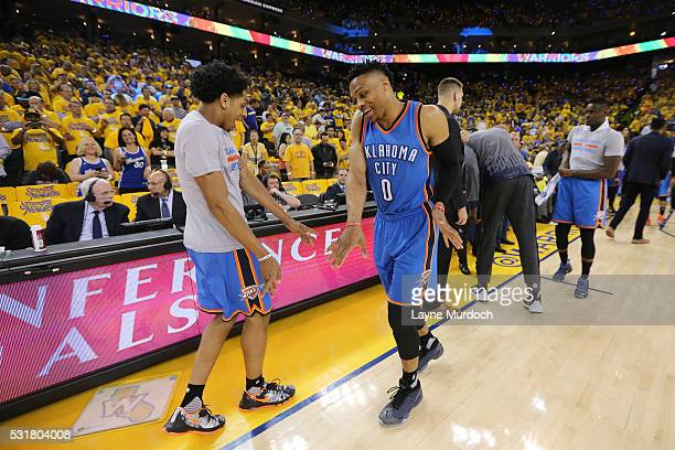 Russell Westbrook and Cameron Payne of the Oklahoma City Thunder perform their pregame dance routine before the game against the Golden State...