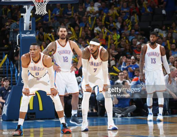 Russell Westbrook and Carmelo Anthony of the Oklahoma City Thunder react to a play against the Melbourne United during the preseason game on October...