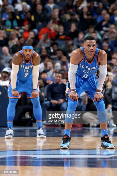 Russell Westbrook and Carmelo Anthony of the Oklahoma City Thunder looks on during the game against the Memphis Grizzlies on December 9 2017 at...