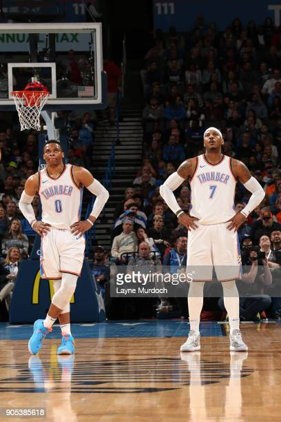 Russell Westbrook and Carmelo Anthony of the Oklahoma City Thunder look on against the Sacramento Kings on January 15 2018 at Chesapeake Energy Arena...