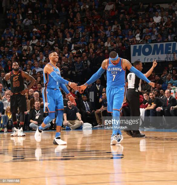 Russell Westbrook and Carmelo Anthony of the Oklahoma City Thunder shake hands during the game against the Cleveland Cavaliers on February 13 2018 at...
