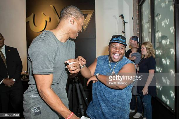 Russell Westbrook and his brother Raynard joke around during the True Religion x Russell Westbrook Fall 2016 Collection PopUp Exhibit at Nault Fine...