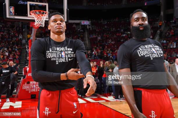 Russell Westbrook and James Harden of the Houston Rockets stand for the National Anthem prior to a game against the Memphis Grizzlies on February 26...