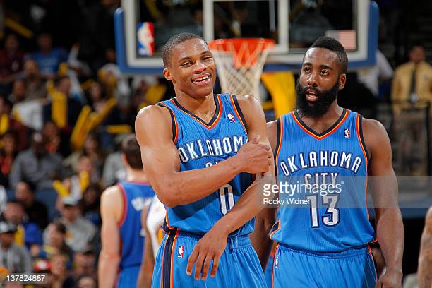 Russell Westbrook and James Harden of the Oklahoma City Thunder head to the bench during a game against the Golden State Warriors on January 27 2012...