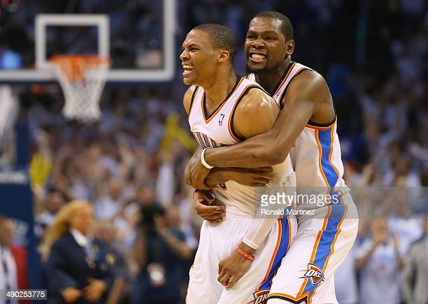 Russell Westbrook and Kevin Durant celebrate a 105104 win against the Los Angeles Clippers in Game Five of the Western Conference Semifinals during...