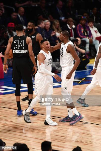 Russell Westbrook and Kevin Durant of Team LeBron react to a play against Team Stephen during the NBA AllStar Game as a part of 2018 NBA AllStar...