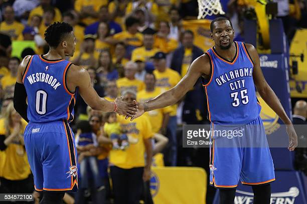 Russell Westbrook and Kevin Durant of the Oklahoma City Thunder celebrate after a play against the Golden State Warriors during Game Five of the...