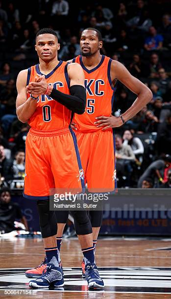 Russell Westbrook and Kevin Durant of the Oklahoma City Thunder look on during the game against the Brooklyn Nets on January 24 2016 at Barclays...