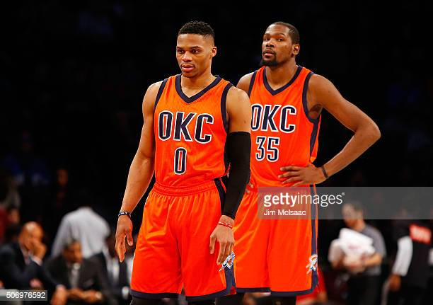 Russell Westbrook and Kevin Durant of the Oklahoma City Thunder look on against the Brooklyn Nets at Barclays Center on January 24 2016 in the...