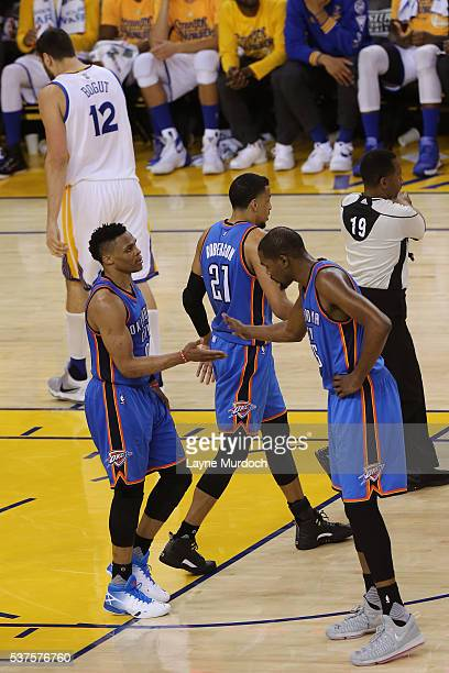 Russell Westbrook and Kevin Durant of the Oklahoma City Thunder shake hands in Game Five of the Western Conference Finals against the Golden State...