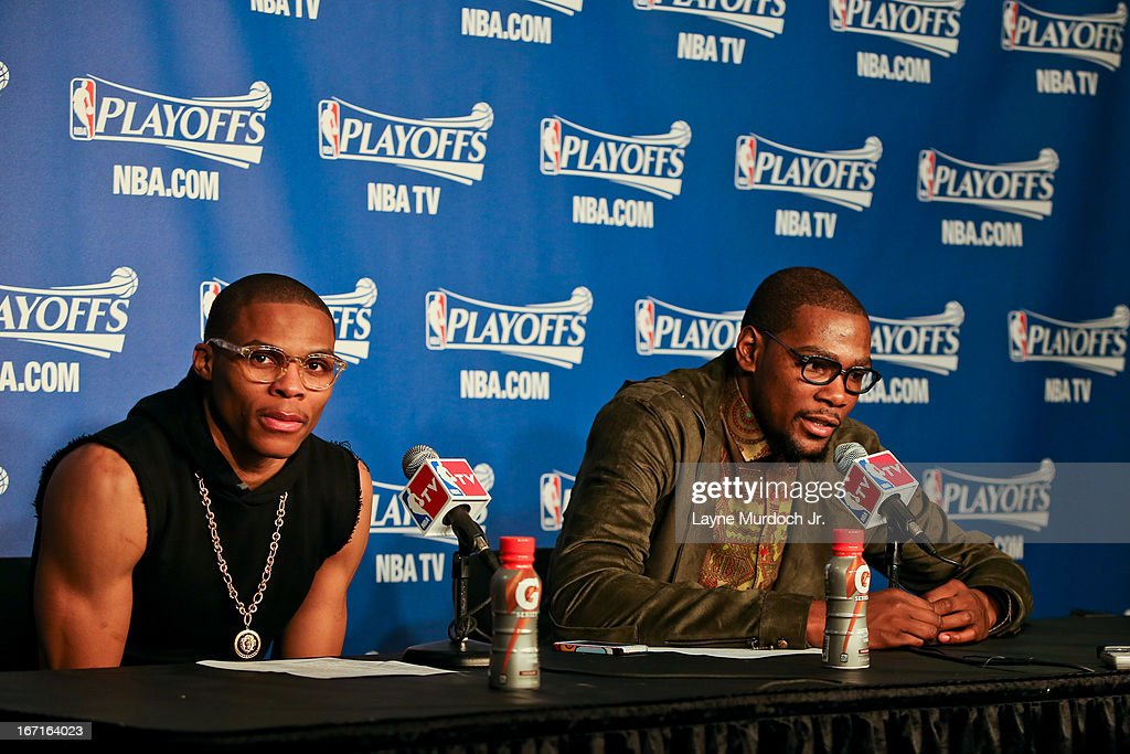 Russell Westbrook #0 and Kevin Durant #35 of the Oklahoma City Thunder speak to members of the media following their team's victory against the Houston Rockets in Game One of the Western Conference Quarterfinals during the 2013 NBA playoffs on April 21, 2013 at the Chesapeake Energy Arena in Oklahoma City, Oklahoma.