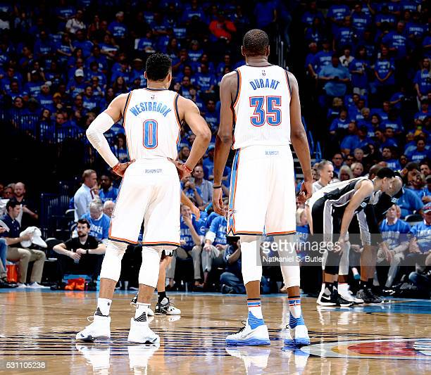 Russell Westbrook and Kevin Durant of the Oklahoma City Thunder talk during the game against the San Antonio Spurs in Game Six of the Western...
