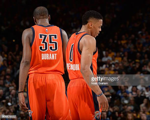 Russell Westbrook and Kevin Durant of the Oklahoma City Thunder during the game against the Golden State Warriors on February 6 2016 at ORACLE Arena...