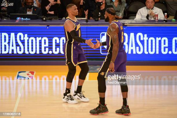 Russell Westbrook and LeBron James of the Los Angeles Lakers shake hands against the Phoenix Suns on October 22, 2021 at STAPLES Center in Los...