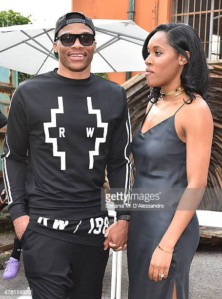 Russell Westbrook and Nina Earl attend the Marcelo Burlon County of Milan show during the Milan Men's Fashion Week Spring/Summer 2016 on June 22 2015...