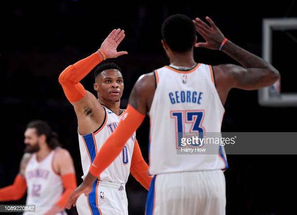 Russell Westbrook and Paul George of the Oklahoma City Thunder celebrate a dunk during the first half against the Los Angeles Lakers at Staples...