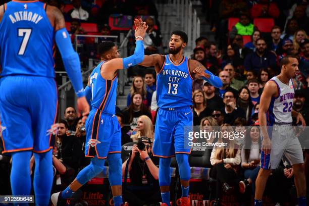 Russell Westbrook and Paul George of the Oklahoma City Thunder exchange a high five during the game against the Detroit Pistonson January 27 2018 at...