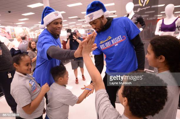 Russell Westbrook and Paul George of the Oklahoma City Thunder along with teammates and coaches shop for the holidays with families from the Sunbeam...