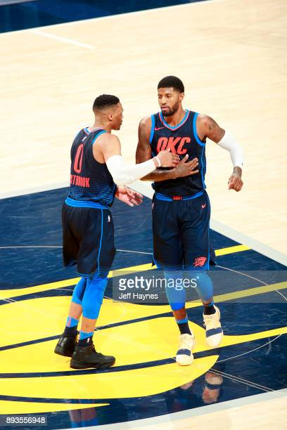 Russell Westbrook and Paul George of the Oklahoma City Thunder during the game against the Indiana Pacers on December 13 2017 at Bankers Life...