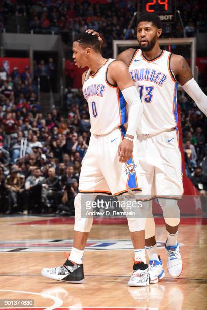 Russell Westbrook and Paul George of the Oklahoma City Thunder during the game against the LA Clippers on January 4 2018 at STAPLES Center in Los...